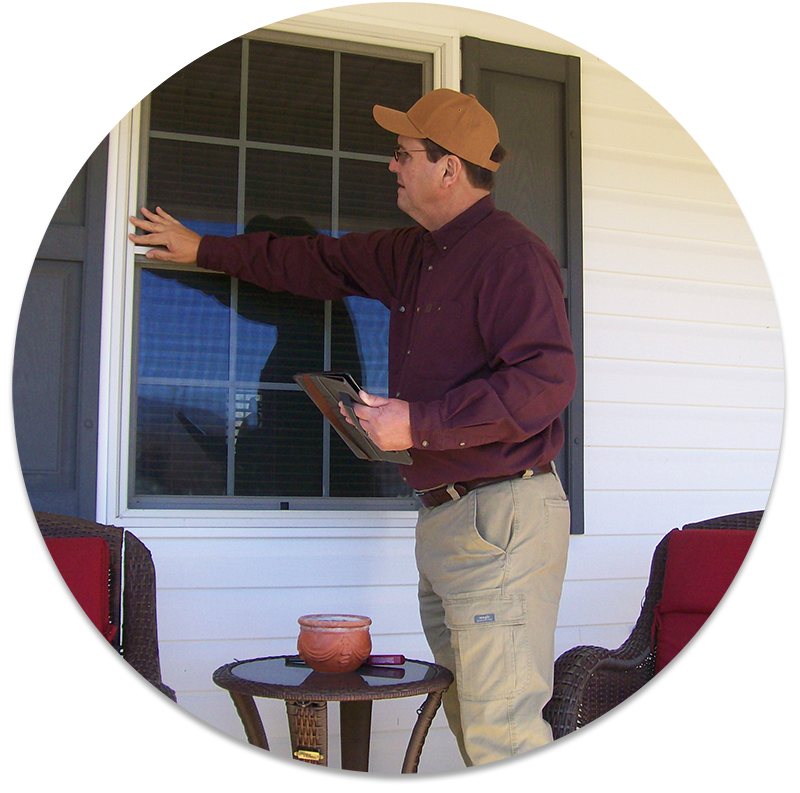 Bill home inspector inspecting the windows outside of a residential home