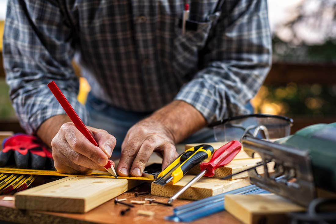A craftsman using tools to make a repair, which will be checked during home inspection services